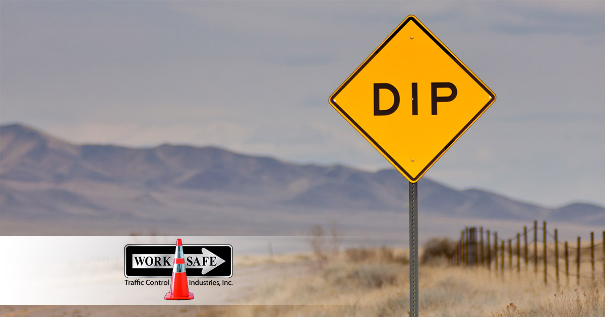 What Does A 'dip' Road Sign Mean